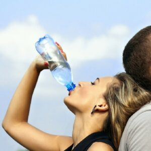 Sun Protection - Woman drinking water